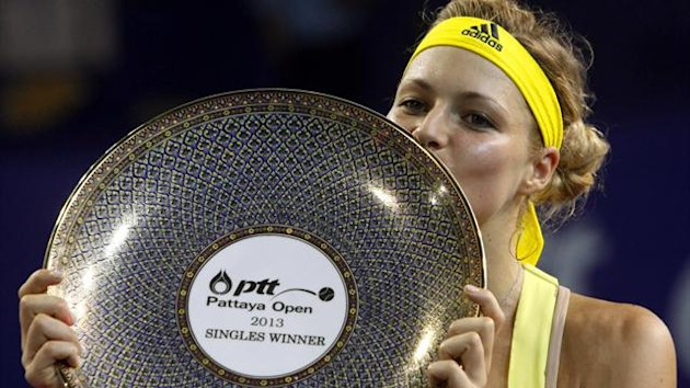 Russia's Maria Kirilenko kisses her award after she defeated Germany's Sabine Lisicki in their women's singles final match at the WTA Tour PTT Pattaya Women's Open