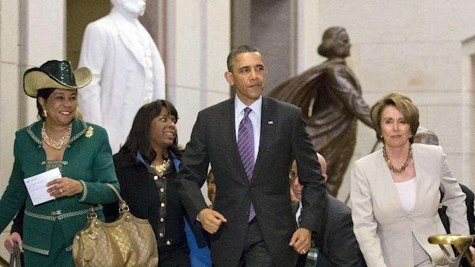 In this March 14, 2013, photo, President Barack Obama and House Minority Leader Nancy Pelosi, D-Calif., leave a meeting with House Democrats at the Capitol, in Washington, with at far left, Rep. Frederica Wilson, D-Fla., and Rep. Terri Sewell, D-Ala., second from left. Obama has hosted dinners and lunches and visited Capitol Hill over three days in his outreach effort with Congress. Lawmakers say it will take putting the entire force of the White House operation behind opening lines of communication if the effort is to stand any chance of bearing fruit. (AP Photo/J. Scott Applewhite)