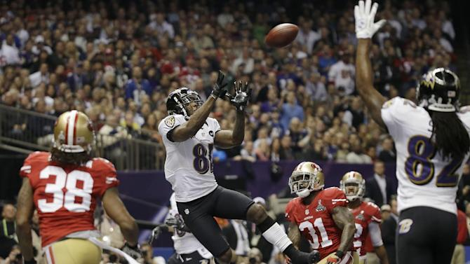Baltimore Ravens wide receiver Anquan Boldin (81) catches a 13-yard touchdown pass during the first half of the NFL Super Bowl XLVII football game against the San Francisco 49ers, Sunday, Feb. 3, 2013, in New Orleans. (AP Photo/Matt Slocum)