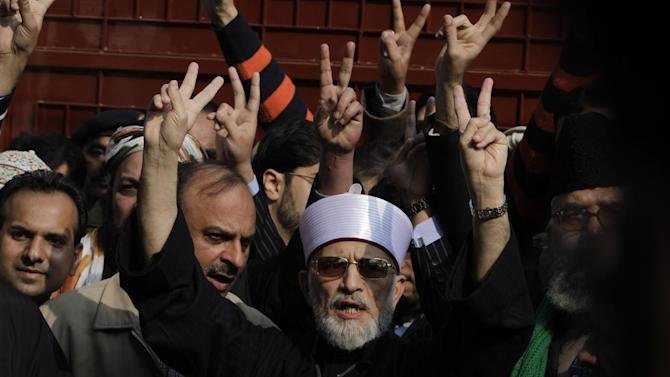 Pakistani Sunni Muslim cleric Tahir-ul-Qadri, 61, center, leaves Lahore to lead an anti-government march to the capital Islamabd, Pakistan, Sunday, Jan 13, 2013 in Pakistan. After years in Canada, Qadri returned to Pakistan last month and gave a speech demanding that sweeping election reforms be implemented before elections expected to take place this spring. On Thursday, Pakistan's Minister of Interior Rehman Malik issued a strongly worded statement that Qadri would not be allowed to rally in Islamabad, warning that the Taliban might attack the event. (AP Photo/K.M. Chaudary)