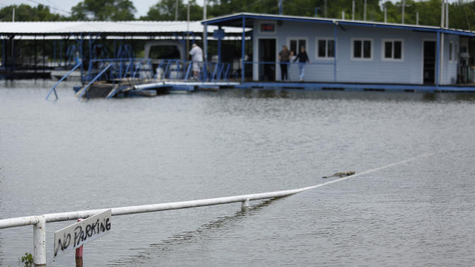 As rains continue in the Fort Worth area, high water forced patrons to be shuttled by boat to the Benbrook Lake Marina, Sunday, May 24, 2015. (Ben Noey Jr./The Fort Worth Star-Telegram via AP) MANDATORY CREDIT MAGS OUT (FORT WORTH WEEKLY, 360 WEST); INTERNET OUT