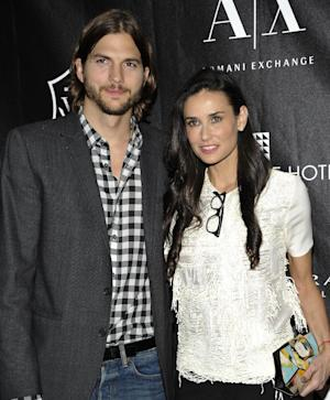 FILE - In this June 9, 2011 file photo, actors Ashton Kutcher and Demi Moore attend the first annual Stephan Weiss Apple Awards at the Urban Zen Center in New York.  Court records show Kutcher filed for divorce from Moore on Friday, Dec. 21, 2012, citing irreconcilable differences. (AP Photo/Evan Agostini, file)