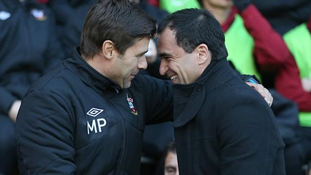 Mauricio Pochettino, left, felt Southampton were unlucky to draw with Roberto Martinez's Wigan