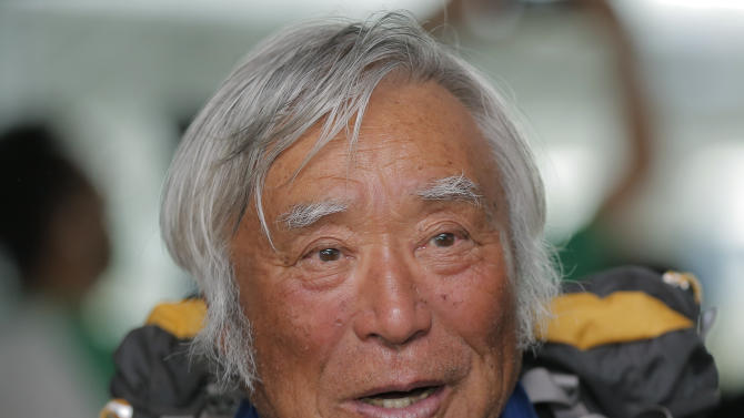 80-year-old Japanese climber Yuichiro Miura, who became the oldest conqueror of Mount Everest on last Thursday, speaks to media upon his arrival at Haneda International Airport in Tokyo, Wednesday, May 29, 2013. Miura, a Japanese former extreme skier, conquered the mountain on May 23 despite undergoing heart surgery in January for an irregular heartbeat, or arrhythmia, his fourth heart operation since 2007. He also broke his pelvis and left thigh bone in a 2009 skiing accident. (AP Photo/Itsuo Inouye)