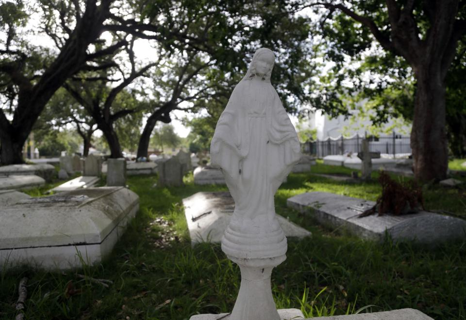 This Saturday, July 6, 2013 photo shows graves in the historic Coconut Grove Cemetery in the Village West neighborhood of Coconut Grove in Miami with the remains of early Bahamian settlers. (AP Photo/Lynne Sladky)