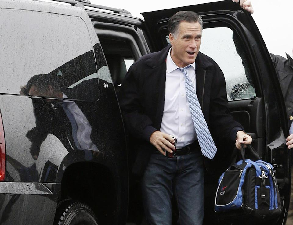 Republican presidential candidate and former Massachusetts Gov. Mitt Romney gets out of his vehicle to board his campaign plane in Akron-Canton Regional Airport, North Canton, Ohio, Saturday, Oct. 27, 2012, as he travels to Pensacola, Fla., for campaign events. (AP Photo/Charles Dharapak)