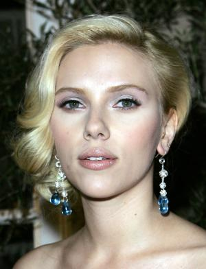 FILE  - In this Oct. 15, 2007, file photo, actress Scarlett Johansson arrives at Elle magazine's 14th Annual Women in Hollywood tribute in Los Angeles. Court records show a judge finalized the divorce between Johansson and Ryan Reynolds on Friday, July 1, 2011, in Los Angeles. (AP Photo/Kevork Djansezian, file)