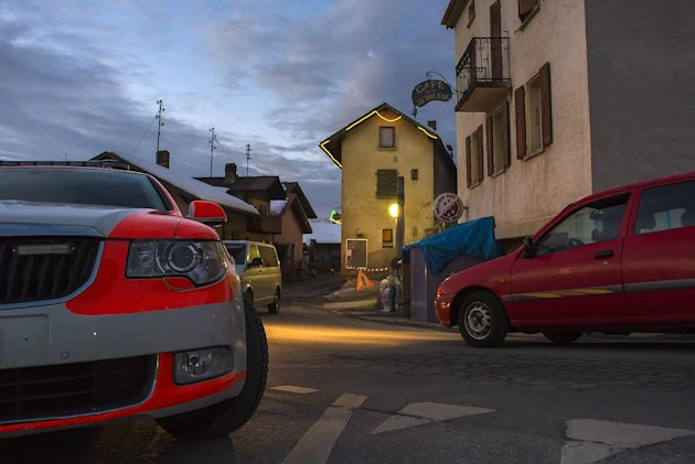 Police vehicles in the village of Daillon after a shooting, in Switzerland, early Thursday, Jan. 3, 2013. A man shot and killed three people and wounded another two in a Swiss village, and was then arrested by officers who shot and injured him, police said Thursday. Police in the southern canton (state) of Valais said they were alerted to the shooting in the village of Daillon just before 9 p.m. (20:00GMT) Wednesday. Three of the victims died at the scene and the two injured people were taken to hospitals. A police statement early Thursday gave no detail on their injuries. (AP Photos/Keystone, Olivier Maire)