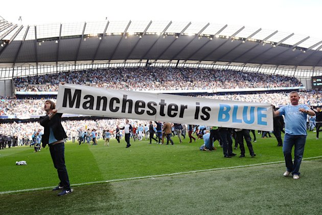 Manchester City's Supporters Celebrate On The Pitch 