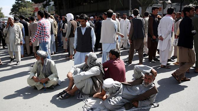 Afghan protesters sit on the ground to block one of the main Kabul streets during a demonstration against the government, in Kabul, Afghanistan, Wednesday, Oct. 7, 2015. An Afghan official says government troops have regained control of the main square in Kunduz, a strategic northern city briefly seized by Taliban insurgents last week. (AP Photos/Massoud Hossaini)