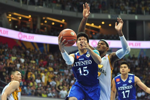 Kiefer Ravena drives to the basket as Karim Abdul watches helplessly in this bit of action. Ateneo beat UST, 68-66. (George Calvelo/NPPA)