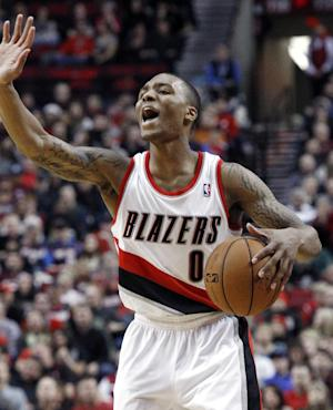 FILE- In this Dec. 22, 2012, file photo, Portland Trail Blazers guard Damian Lillard calls out a play during the second half of an NBA basketball game against the Phoenix Suns in Portland, Ore.  The Trail Blazers are expected to announce Lillard as the league's Rookie of the Year on Wednesday, May 1, 2013. (AP Photo/Don Ryan, File)