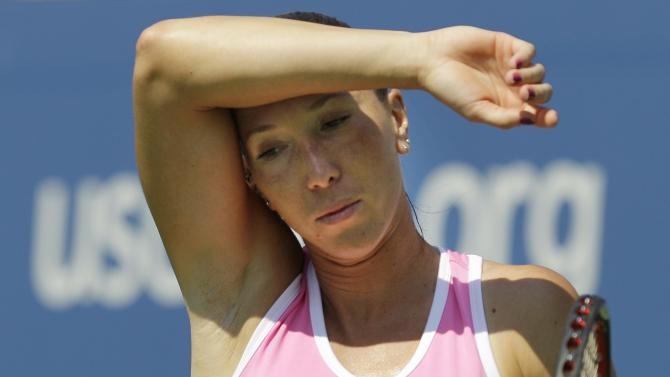 Serbia's Jelena Jankovic returns a shot to Agnieszka Radwanska, of Poland, in the third round of play at the 2012 US Open tennis tournament,  Saturday, Sept. 1, 2012, in New York. (AP Photo/Kathy Willens)