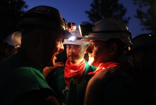 Lamps shining, angry coal miners march on Madrid