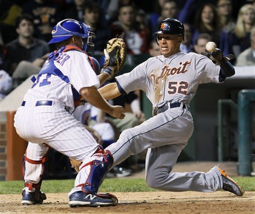 Peralta gets 3 hits, Tigers rally to beat Cubs 8-4