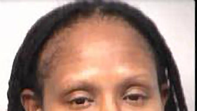 This undated photo provided by the Fulton County Sheriff's Office shows Olympic gold medalist and former WNBA star Chamique Holdsclaw. Holdsclaw was in custody Thursday, Nov. 15, 2012, after being accused of shooting into the car of Jennifer Lacy, a player for the Tulsa Shock, after using a bat to break its windows, according to Atlanta police. No one was injured, according to police. (AP Photo/Fulton County Sheriff's Office)