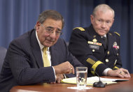 FILE - In this Nov. 10, 2011, file photo Defense Secretary Leon Panetta and Joint Chiefs Chairman Gen. Martin Dempsey take part in a news conference at the Pentagon in Washington. The Obama administration is rewriting its defense strategy to absorb hundreds of billions of dollars in the U.S. defense budget cuts while scaling back the longstanding Pentagon goal of being ready to fight two wars simultaneously. The strategy, to be outlined at a news conference also attended by Panetta and Dempsey, is not expected to mark a big change in defense priorities. It may set the stage, however, for expected cutbacks in Europe and big weapons programs. (AP Photo/Evan Vucci, File)