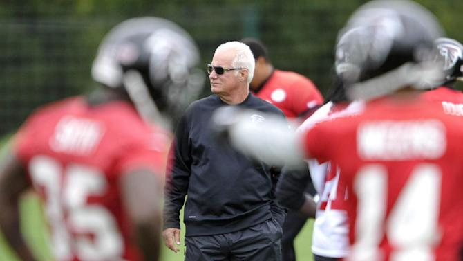 In this photo provided by the NFL, Atlanta Falcons head coach Mike Smith attends a team football practice session at London Colney, on the outskirts of London, Thursday, Oct. 23, 2014. The Atlanta Falcons will play the Detroit Lions in an NFL football game at London's Wembley Stadium on Sunday