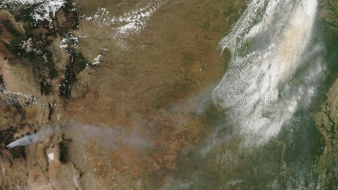 This image provided by NASA shows smoke from New Mexico wildfires drifting across the southcentral United States. The image was acquired Thursday May 24, 2012 by NASA's MODIS satellite Aqua. Firefighters are battling a massive wildfire in southwestern New Mexico that has destroyed a dozen cabins and spread smoke across the state, prompting holiday weekend air-quality warnings. The fire burned early Saturday through remote and rugged terrain around the Gila Wilderness and has grown to 85,000 acres or more than 130 square miles. Fire officials say nearly all of the growth has come in recent days due to relentless winds.  (AP Photo/NASA)