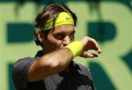 Roger Federer of Switzerland reacts during his men's singles final match against Tommy Haas of Germany at the Halle Open ATP tennis tournament in Halle June 17, 2012. REUTERS/Ina Fassbender