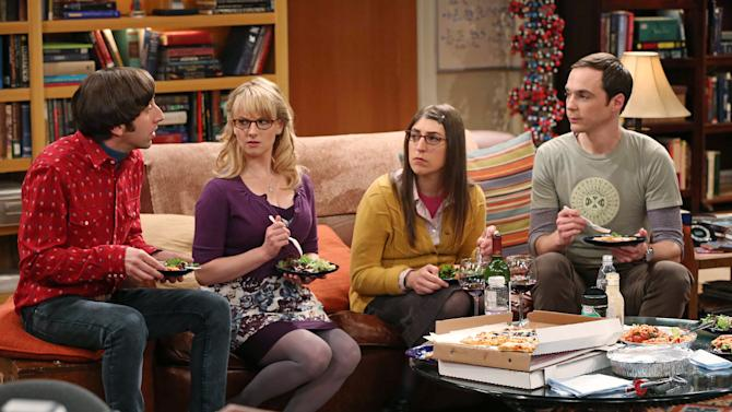 "This image released by CBS shows, from left, Simon Helberg, Melissa Rauch, Mayim Bialik and Jim Parsons in a scene from ""The Big Bang Theory."" CBS says it's renewing its hit comedy ""The Big Bang Theory"" for three more years. This extraordinary deal would carry TV's most-watched sitcom through the 2016-2017 season, the series' tenth on the air. ""The Big Bang Theory"" premiered in September 2007, and has been a ratings smash for virtually its entire run. This season it has averaged nearly 20 million viewers each week. (AP Photo/CBS, Michael Yarish)"