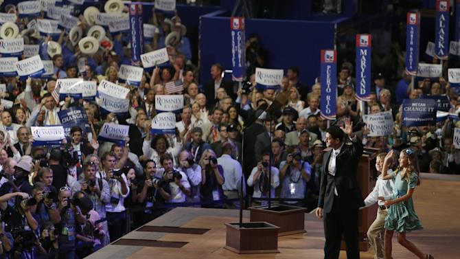 Republican vice presidential nominee, Rep. Paul Ryan accompanied by his children Lia and Sam waves to delegates after his acceptance speech during the Republican National Convention in Tampa, Fla., on Wednesday, Aug. 29, 2012. (AP Photo/Lynne Sladky)
