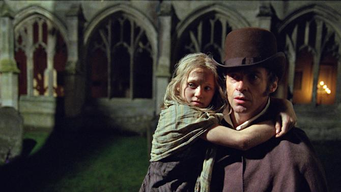 """FILE - This publicity film image released by Universal Pictures shows Hugh Jackman as Jean Valjean holding Isabelle Allen as Young Cosette in a scene from """"Les Miserables."""" Best-picture prospects for Oscar Nominations on Thursday, Jan. 10, 2013, include, """"Lincoln,"""" directed by Steven Spielberg; """"Zero Dark Thirty,"""" directed by Kathryn Bigelow; """"Les Miserables,"""" directed by Tom Hooper; """"Argo,"""" directed by Ben Affleck; """"Django Unchained,"""" directed by Quentin Tarantino; and """"Life of Pi,"""" directed by Ang Lee.  (AP Photo/Universal Pictures, Laurie Sparham, File)"""