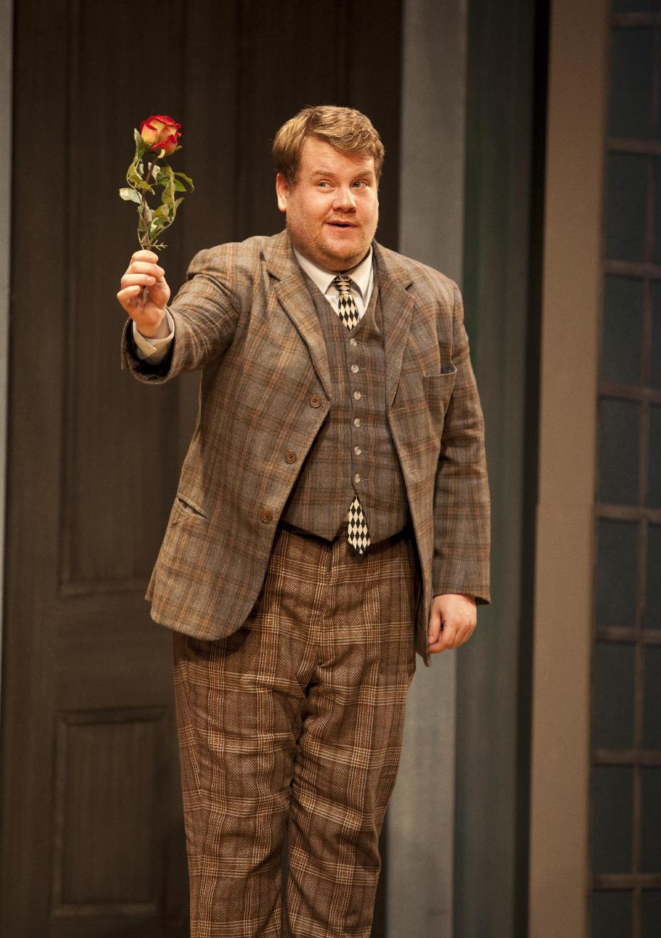 "In this theater publicity image released by Boneau/Bryan-Brown, James Corden is shown in a scene from Richard Bean's slapstick comedy ""One Man Two Guvnors,"" in London's West End. The play will opened at the Music Box Theatre on Broadway on April 18. (AP Photo/Boneau/Bryan-Brown, Johan Persson)"