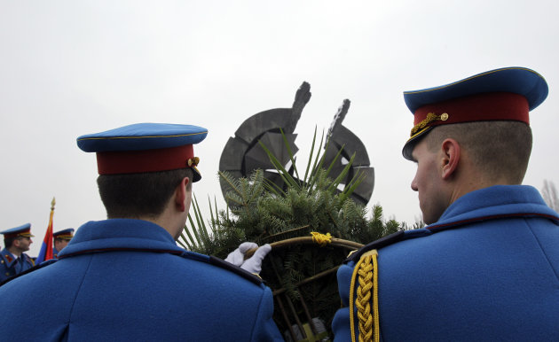Serbian military honor guard attend commemorations for victims of the Holocaust at a monument erected in the former World War II Nazi concentration camp of Sajmiste in Belgrade, Serbia, Sunday, Jan. 2