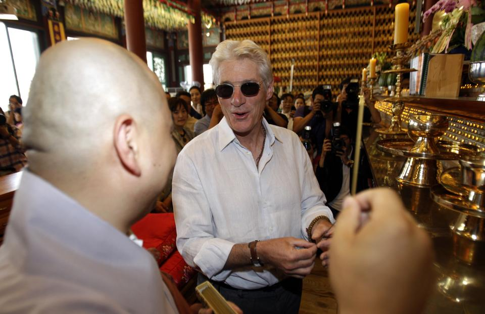 U.S. actor Richard Gere, right, listens to monk Sung Jin during his visit to Korean Buddhism's Chogye temple in Seoul, South Korea, Tuesday, June 21, 2011. Gere is in South Korea for six days to promote his photo exhibition and tour Buddhist temples. (AP Photo/ Lee Jin-man, Pool)