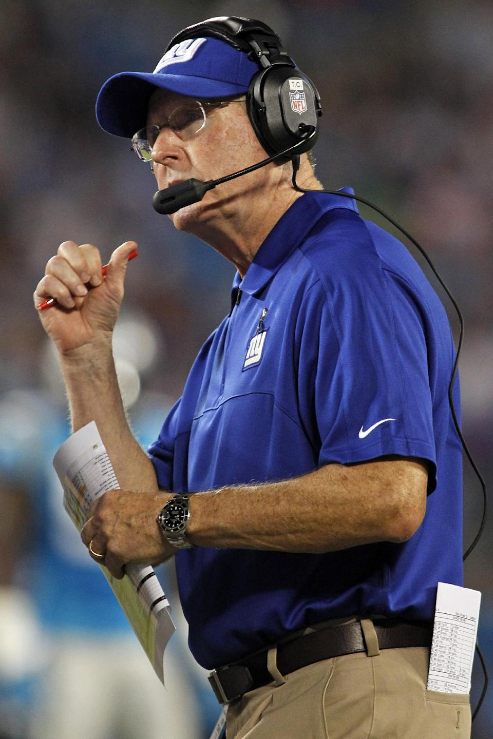 New York Giants head coach Tom Coughlin watches during the first quarter of an NFL football game against the Carolina Panthers in Charlotte, N.C., Thursday, Sept. 20, 2012. (AP Photo/Bob Leverone)