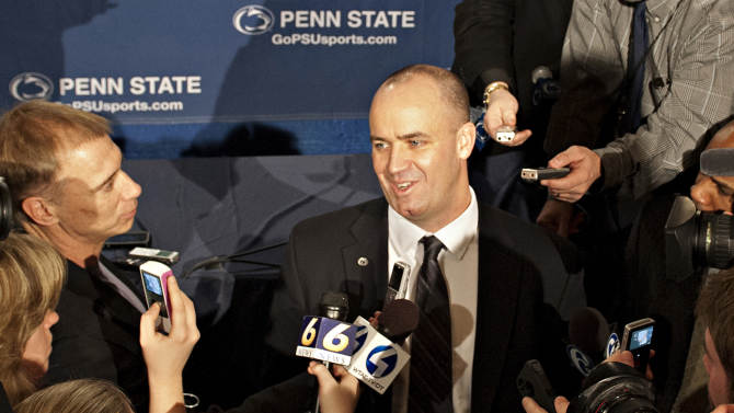Penn State's new football coach Bill O'Brien is surrounded by the media after he was introduced during an NCAA college football news conference, Saturday, Jan. 7, 2012, in State College, Pa. O'Brien, who is currently the offensive coordinator for the New England Patriots, replaces Hall of Famer Joe Paterno, fired Nov. 9 in the aftermath of child sex abuse charges against retired assistant coach Jerry Sandusky. (AP Photo/Andy Colwell)