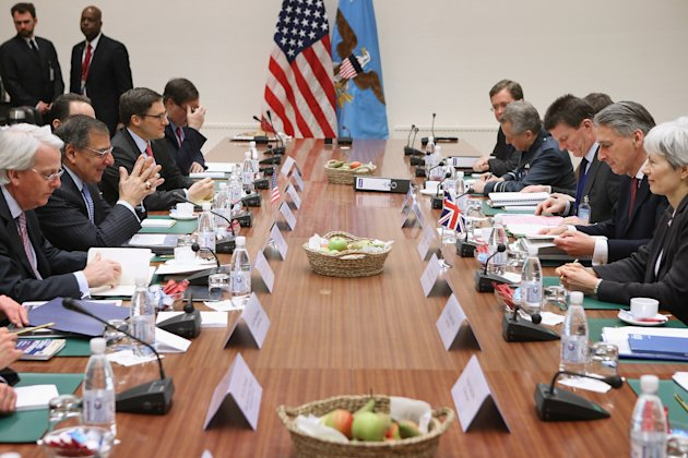 Defense Secretary Leon Panetta and British Defense Secretary Philip Hammond lead their delegations during a bilateral meeting at the North Atlantic Treaty Organization (NATO) Defense Ministers Meeting