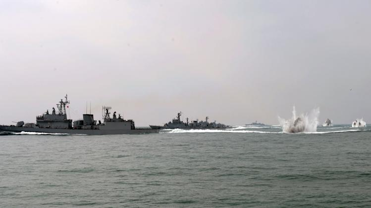 South Korean navy vessels conduct a military drill in South Korean waters in this picture taken and released by the navy in Seoul