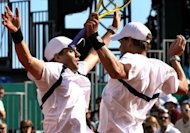 The twin towers of John Isner and Sam Querrey, allied to the Bryan twins (pictured in April), Mike (L) and Bob, in the doubles will give US coach Jim Courier hope that the United States can upset holders Spain in the Davis Cup semi-finals in Gijon this weekend