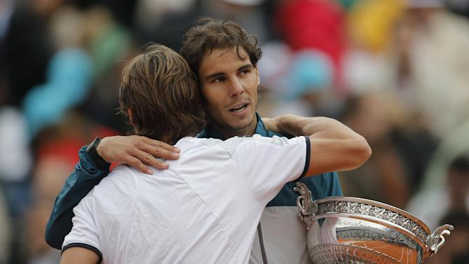 Spain's Rafael Nadal hugs compatriot David Ferrer after defeating him in three sets 6-3, 6-2, 6-3, in the final of the French Open tennis tournament, at Roland Garros stadium in Paris, Sunday June 9, 2013. (AP Photo/Christophe Ena)