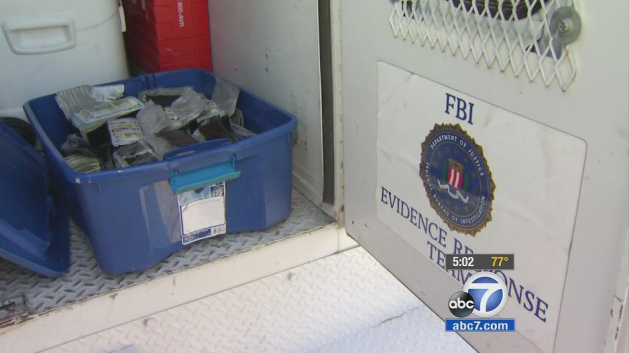 FBI digs up $600,000 from California yard of former armored truck driver