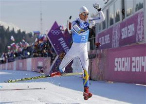 Sweden's Hellner celebrates after crossing the finish line during men's cross-country 4 x 10km relay event at 2014 Sochi Winter Olympics