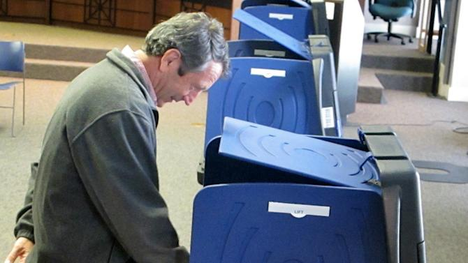Former South Carolina Gov. Mark Sanford votes on Tuesday, March 19, 2013, at a polling place in Charleston, S.C. Sanford, trying to make a political comeback, is one of 16 Republicans running Tuesday in the GOP primary in a special election to fill South Carolina's vacant 1st Congressional District seat.   (AP Photo/Bruce Smith).