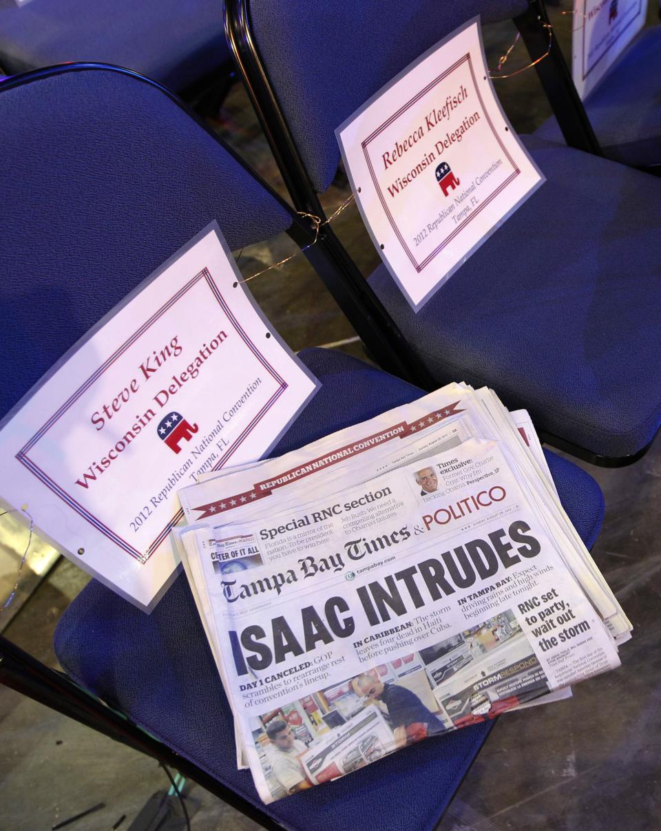 A newspaper headline is seen on the floor of the Republican National Convention in Tampa, Fla., on Sunday, Aug. 26, 2012, as weather forecasts continue to show Florida in the path of Tropical Storm Isaac. (AP Photo/Lynne Sladky)