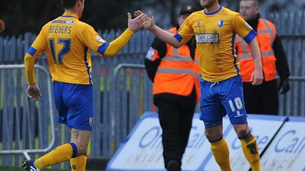 Mansfield's Lee Stevenson (right) struck the only goal of the game at Exeter