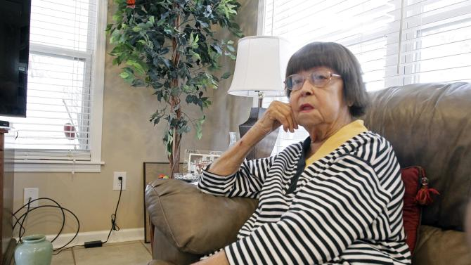 In this March 1, 2012 photograph, Helen Walker is interviewed at her Biloxi, Miss., home, about the quiet piece of wooded land in south Mississippi she owned and her plans to pass it on to her son, Jim Walker Jr. However, a portion of her property Harrison County Utility Authority decided to take for a sewage project, sparking a contentious legal battle between the 86-year-old woman and an agency in control of $234 million in Hurricane Katrina grants. (AP Photo/Rogelio V. Solis)