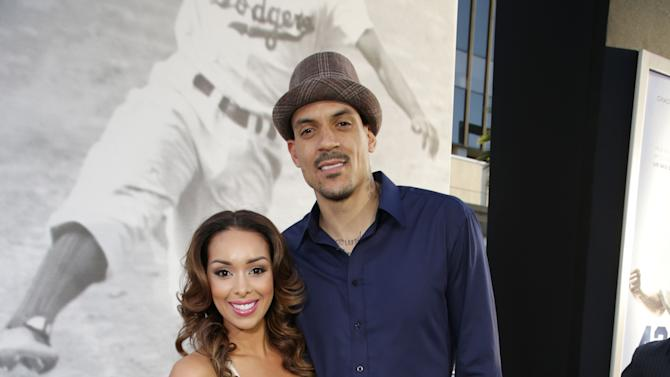 Gloria Govan and Matt Barnes at The Los Angeles Premiere of Warner Bros. Pictures' and Legendary Pictures' 42, on Tuesday, April, 9th, 2013 in Los Angeles. (Photo by Eric Charbonneau/Invision for Warner Bros./AP Images)