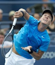 Tomas Berdych of the Czech Republic hits a serve to Nicolas Almagro of Spain during their men&#39;s singles match at the 2012 US Open tennis tournament in New York. Berdych won 7-6 (7/4), 6-4, 6-1