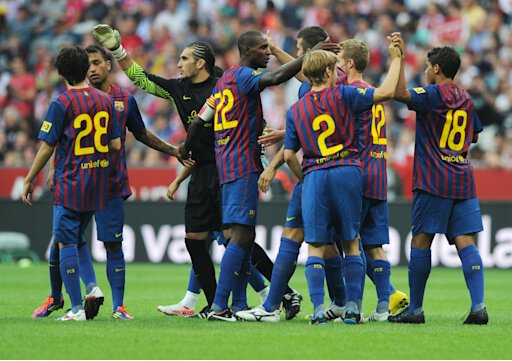 Barcelona's players celebrate after their Audi Cup football match FC Barcelona vs SC International de Porto Alegre in Munich, southern Germany, on July 26, 2011. Barcelona won 4-2 on a penalty shoot-out, after a 2-2 draw.     AFP PHOTO / CHRISTOF STACHE (Photo credit should read CHRISTOF STACHE/AFP/Getty Images)