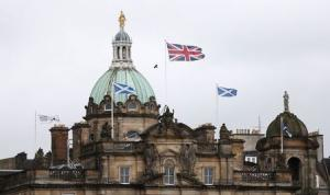 British and Scottish flags fly outside the Lloyds Banking Group's Scottish headquarters in Edinburgh