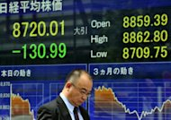 "Asian shares made modest gains Friday after China said its economy slowed in line with expectations, quashing fears data would show a ""doomsday"" scenario of the country heading for a hard landing"
