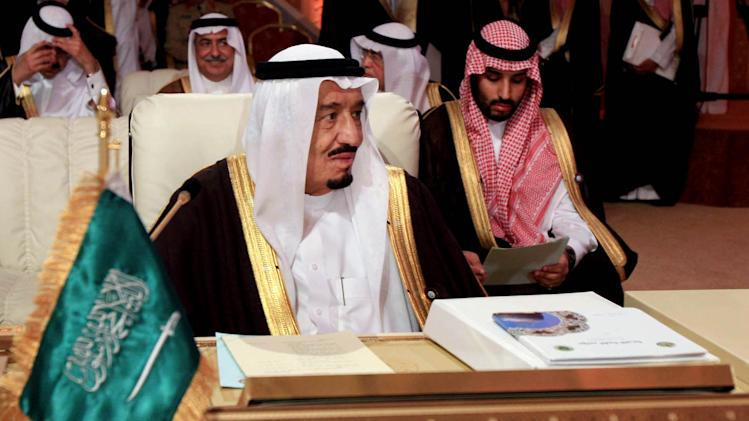 Saudi Crown Prince Salman bin Abdul Aziz al-Saud, left, attends the opening session of the Arab League Summit in Doha, Qatar, Tuesday, March 26, 2013. Syrian opposition representatives took the country's seat for the first time at an Arab League summit that opened in Qatar on Tuesday, a significant diplomatic boost for the forces fighting President Bashar Assad's regime. (AP Photo/Ghiath Mohamad)