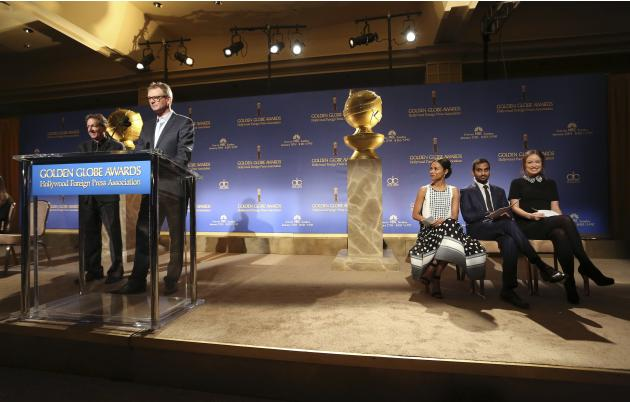 Hollywood Foreign Press Association President Kingma speaks at the podium as actors Saldana, Ansari and Wilde sit on stage at the announcement of nominations for the 71st annual Golden Globe Awards in