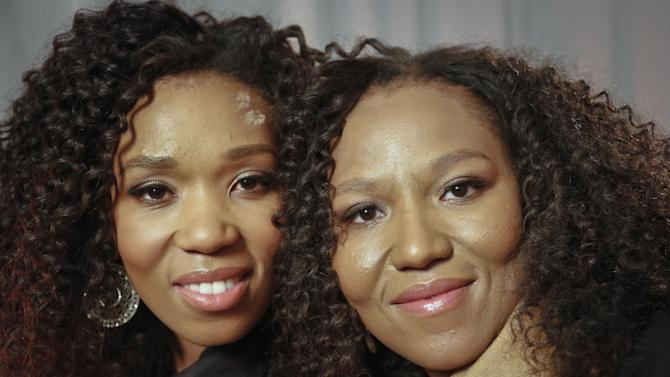 """In this Wednesday, Feb. 6, 2013 photo, Swati Dlamini, left, and Zaziwe Dlamini-Manaway, granddaughters of Nelson and Winnie Mandela, pose during an interview in New York.  The sisters are stars of  the new reality show """"Being Mandela,"""" produced by COZI TV for NBC.  The 30-minute weekly show premieres on Sunday, Feb. 10 at 9 PM ET and will follow the next generation of Mandela family through the experiences of sisters Zaziwe and Swati and their families.  (AP Photo/Bebeto Matthews)"""
